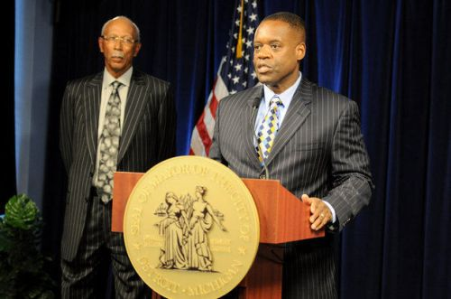 (right) Detroit Emergency Manager Kevyn Orr and Detroit Mayor Dave Bing address the press after an announcement that the City of Detroit is pursuing municipal bankruptcy, July 18. (Tanya Moutzalias | MLive.com)