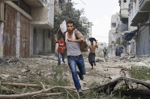 Israeli forces bombarded Shujaieh district in Gaza. July 20, 2014  Thousands of Palestinians run for their lives in the deadliest assault on the Palestinian enclave in five years. Heidi Levine for The National  SM