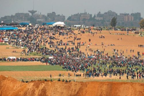 Palestinians participate in a tent city protest commemorating Land Day, with Israeli soldiers seen below in the foreground on-March 30-Photographer- Jack Guez:AFP via Getty ImagesSM2
