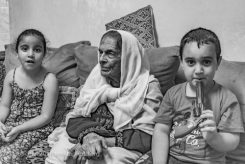 Fatima with her great grand children, Aida refugee camp, Bethlehem