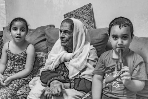 Fatima with her great grand children, Aida refugee camp, Bethlehem