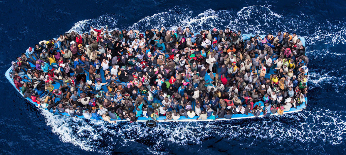 the-italian-coastguardmassimo-sestini-hundreds-of-refugees-and-migrants-aboard-a-fishing-boat-moments-before-being-rescued-by-the-italian-navy-as-part-of-their-mare-nostrum-operation-in